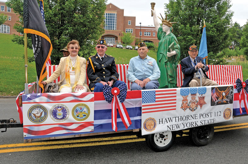Memorial Day float carrying Mrs. Violet Manca, Tarrytown Gold Star Mother, and Robert Conka, Tarrytown VFB Post.