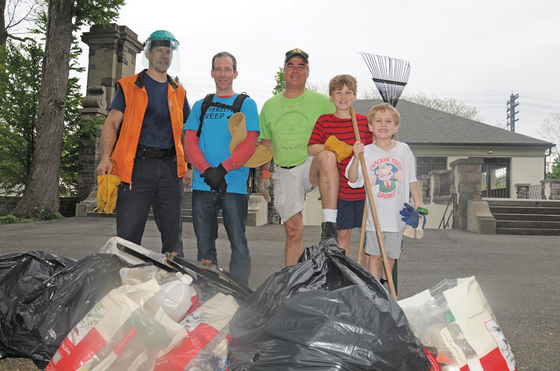 David Hodgson, David Bedell, Christopher Crawley and two youngsters helped clean up Kingsland Park. Photo: Sunny McLean