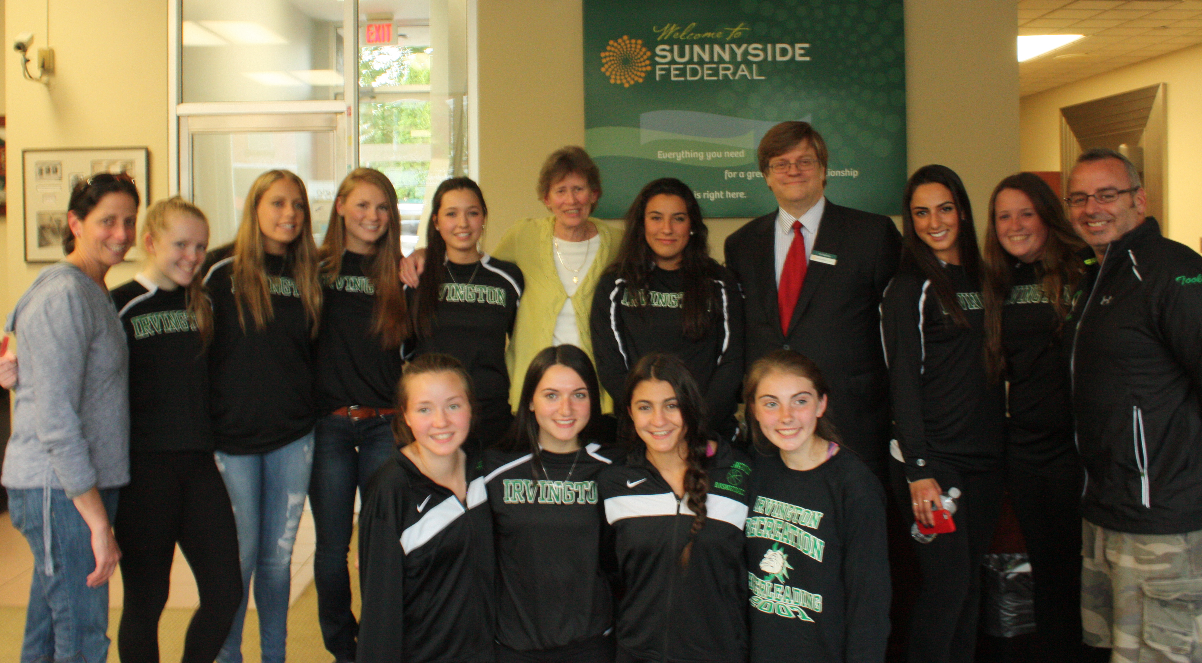 ach, received the inaugural Sunnyside Federal Person of the Year Award from Tim Sullivan, the bank's President and CEO with an enthusiastic crowd in attendance along with members of the Irvington High Lady Bulldog basketball team and assistant coaches, Barbara Constantine and Michael Toolan. Sunnyside Federal also made a contribution in Gina Maher's honor related to autism awareness/education. The Autism Classic basketball tournament is hosted by Gina Maher.