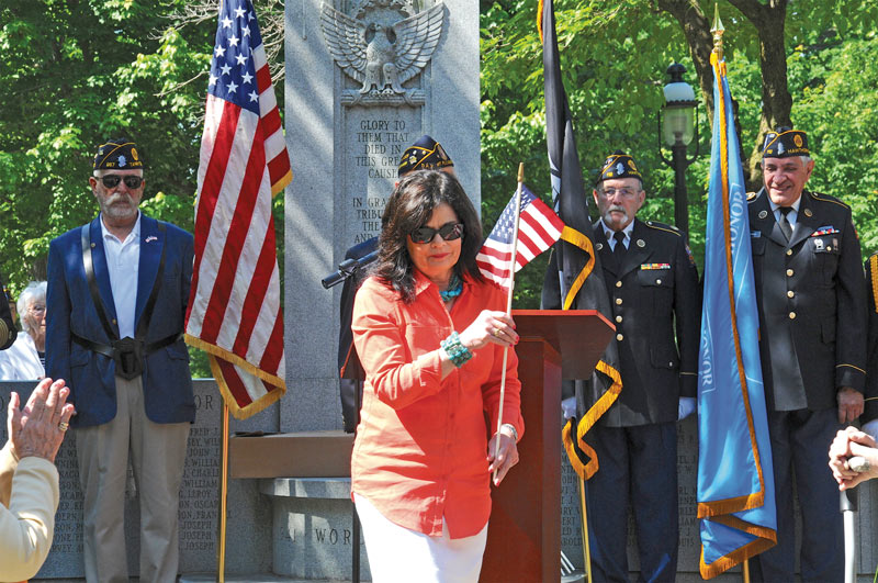 Memorial Day 2015: Mimi Godwin, president of the Tarrytown Union Free School District Board of Education, places a wreath at the monument in Patriot's Park during a Memorial Day ceremony.  Photo: Sunny McLean