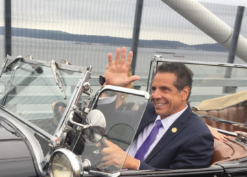 Governor Andrew Cuomo waves to onlookers at opening of westbound span of new bridge. —Photo by Barrett Seaman