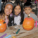 Kids carving pumkins for Halloween