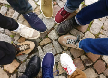 circle of people's shoes together