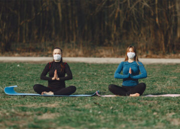 Women doing yoga outdoor wearing masks - Westchester covid news and updates