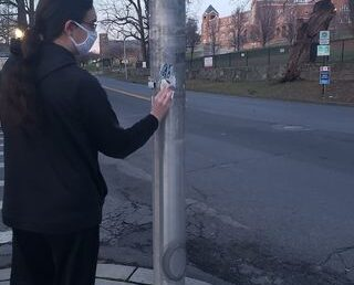 Removing racists stickers in the Rivertowns in Westchester County
