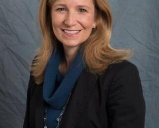 Trustee Denise Scaglione was elected to a third term
