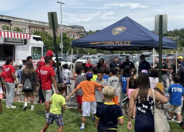 Kids and their moms line up for free ice cream, courtesy of the Tarrytown Police Department